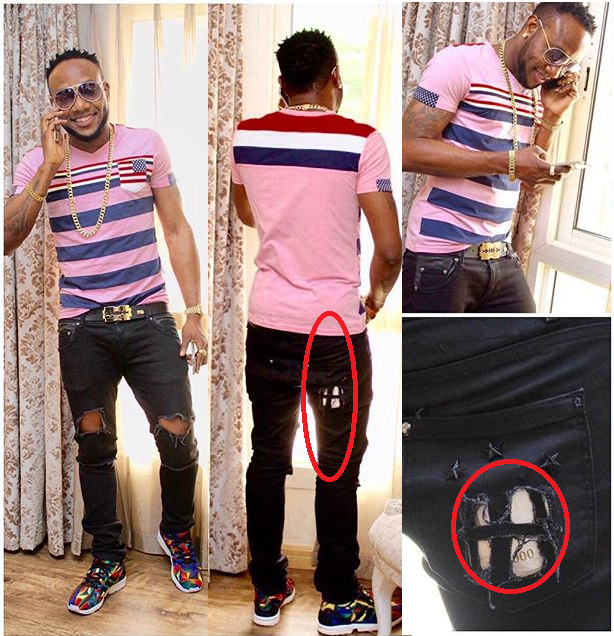 KCEE FLAUNTS CASH IN RIPPED JEANS